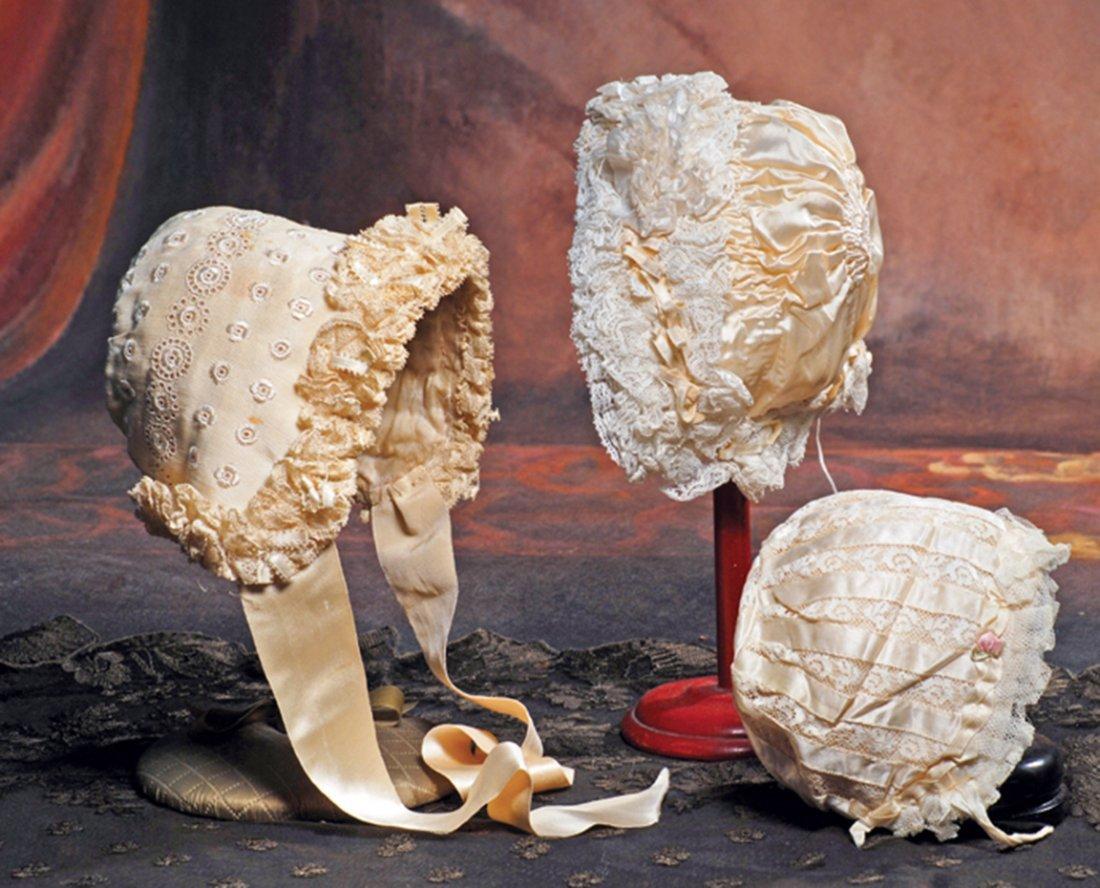 THREE SILK CREAM COLOR DOLL BONNETS.  (1) silk faille