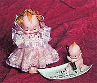 "GERMAN BISQUE KEWPIE WITH PEN AND TRAY ""WITH KEWPISH"