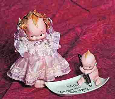 """GERMAN BISQUE KEWPIE WITH PEN AND TRAY """"WITH KEWPISH"""