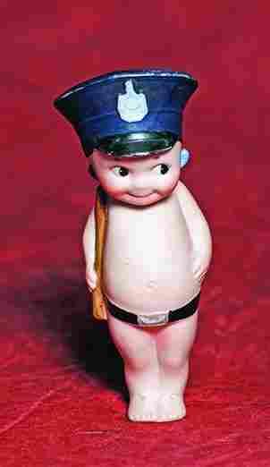 "GERMAN BISQUE ""KEWPIE POLICEMAN WITH BOBBY STICK"". 4"