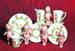 FIVE GERMAN BISQUE STANDING KEWPIES. Marks: O'Neill (of
