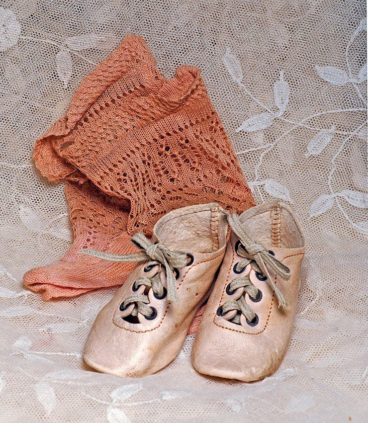 ANTIQUE DOLL SHOES AND SOCKS. Pair of pale pink