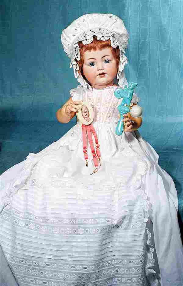 GERMAN BISQUE KEWPIE NOVELTY & CELLULOID BABY RATTLE.