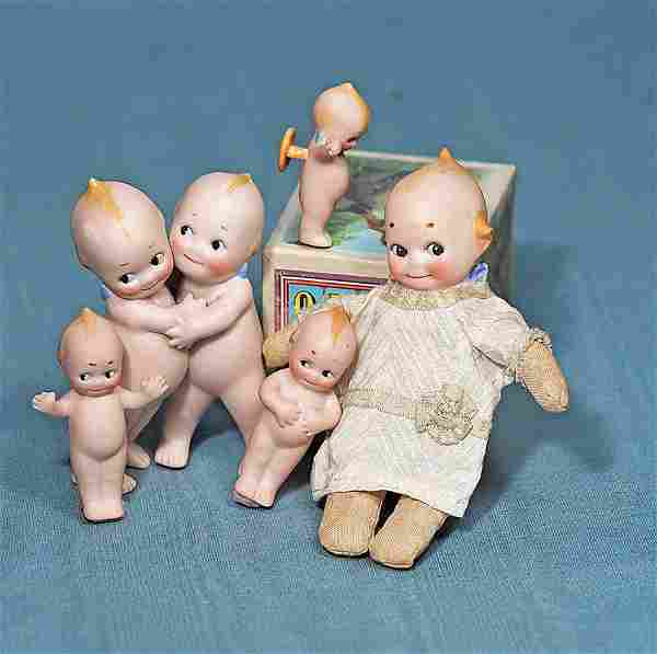 FOUR GERMAN BISQUE KEWPIES. Each is all-bisque with