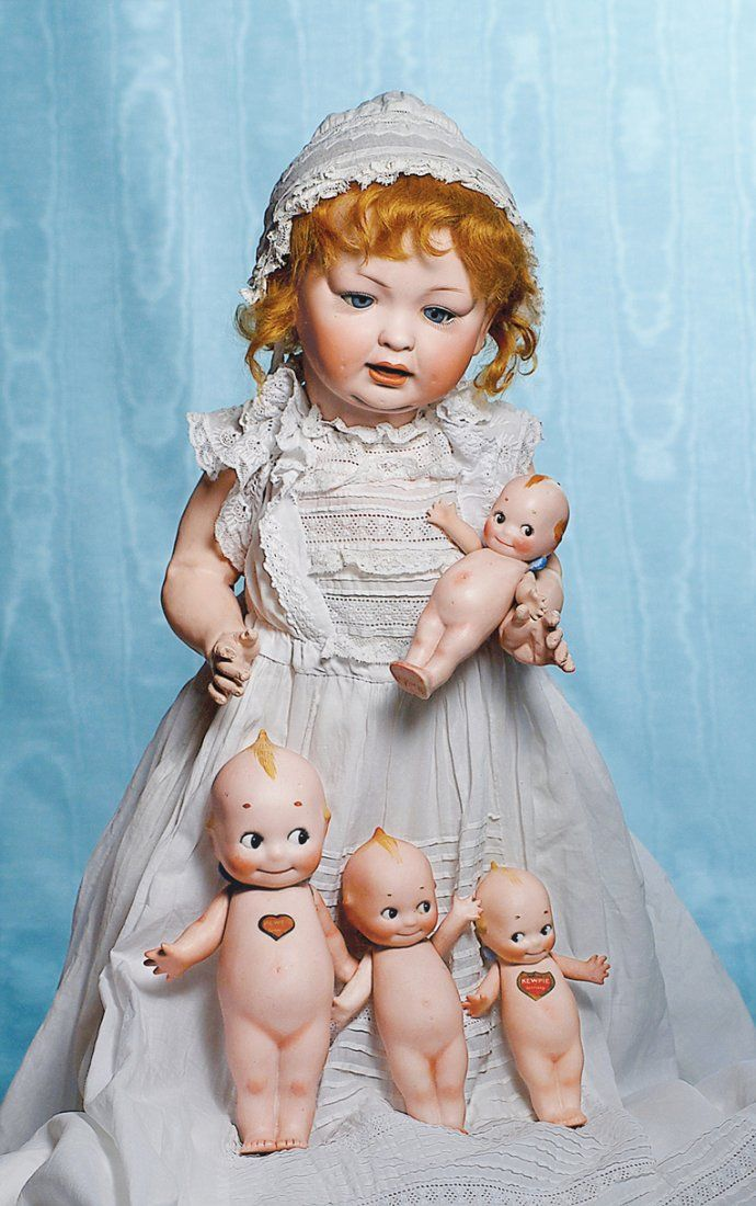 FOUR GERMAN BISQUE STANDING KEWPIES. Marks: O'Neill