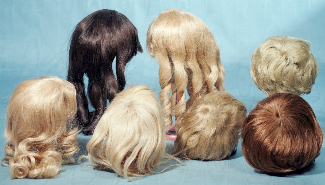 GROUP OF SEVEN HUMAN HAIR DOLL WIGS.  Contemporary wigs