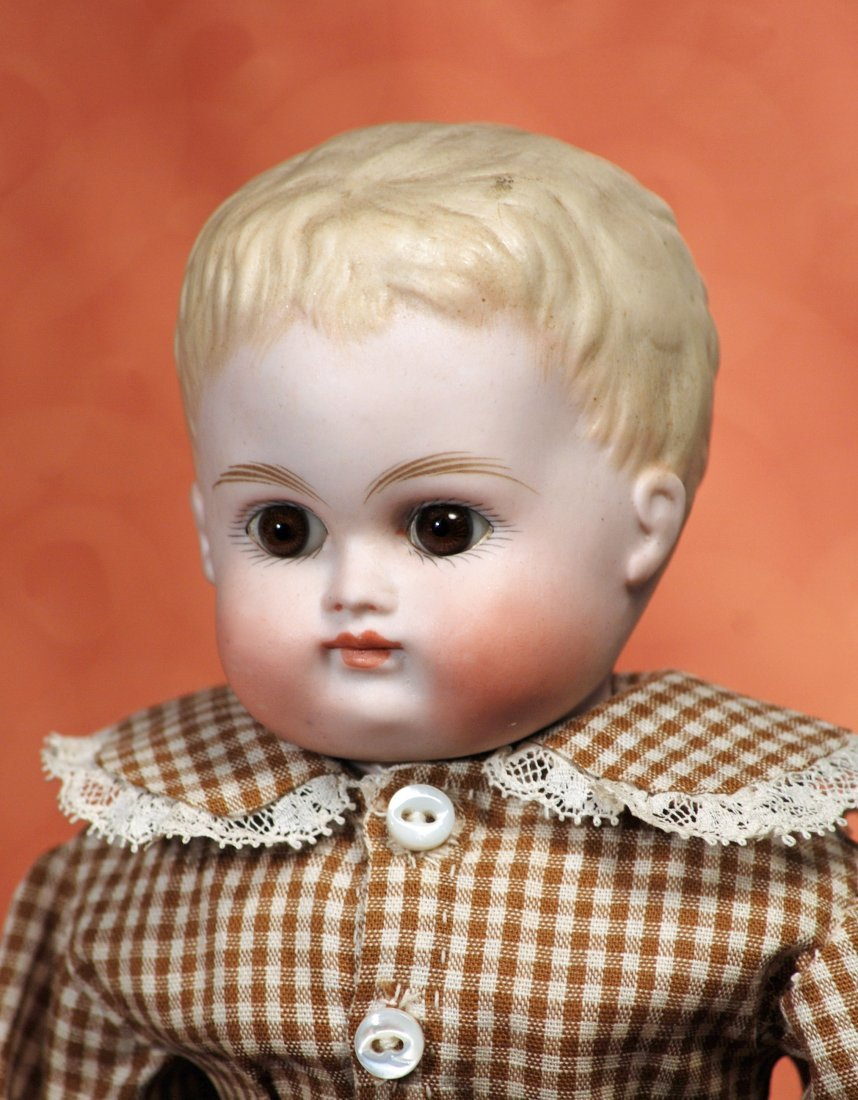 GERMAN BISQUE BOY WITH SCULPTED HAIR AND GLASS EYES