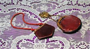 TWO ANTIQUE LEATHER PURSES FOR FASHION DOLLS
