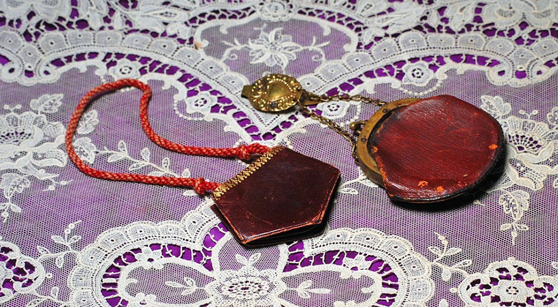 TWO ANTIQUE LEATHER PURSES FOR FASHION DOLLS.