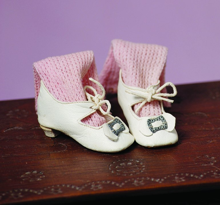 PAIR OF ANTIQUE DOLL SHOES AND SOCKS.  Soft white