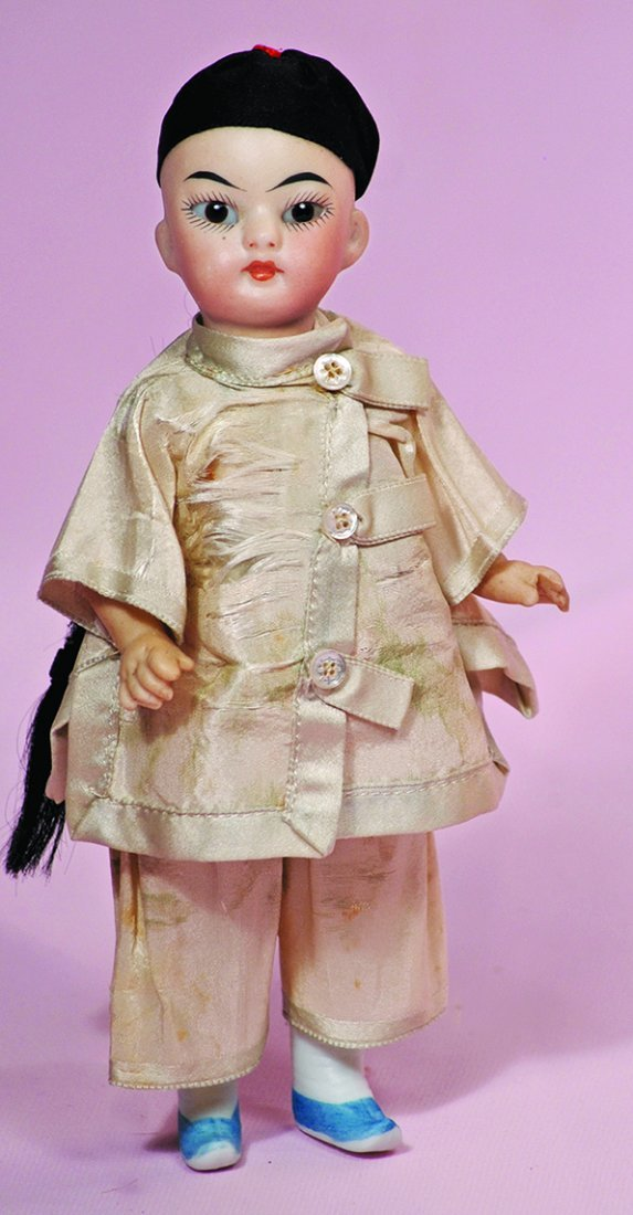 "GERMAN ALL-BISQUE ASIAN CHILD. 7"".  Olive-toned bisque"