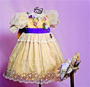 SILK AND LACE DOLL DRESS WITH MATCHING BONNET. Golden