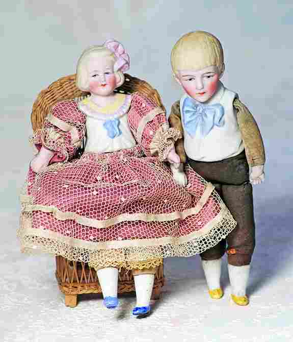 PAIR OF GERMAN BISQUE DOLLS WITH MOLDED BODICE BY