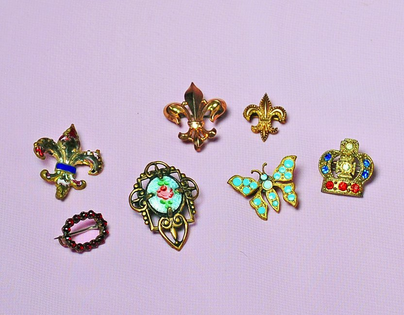 COLLECTION OF ANTIQUE AND VINTAGE BEBE PINS.  Includes