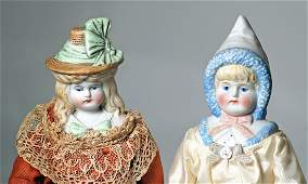 TWO GERMAN BISQUE DOLLS WITH MOLDED BONNETS. 10