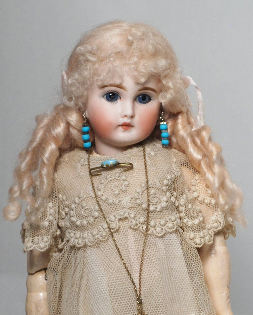 PETITE SONNEBERG BISQUE DOLL FOR THE FRENCH MARKET.