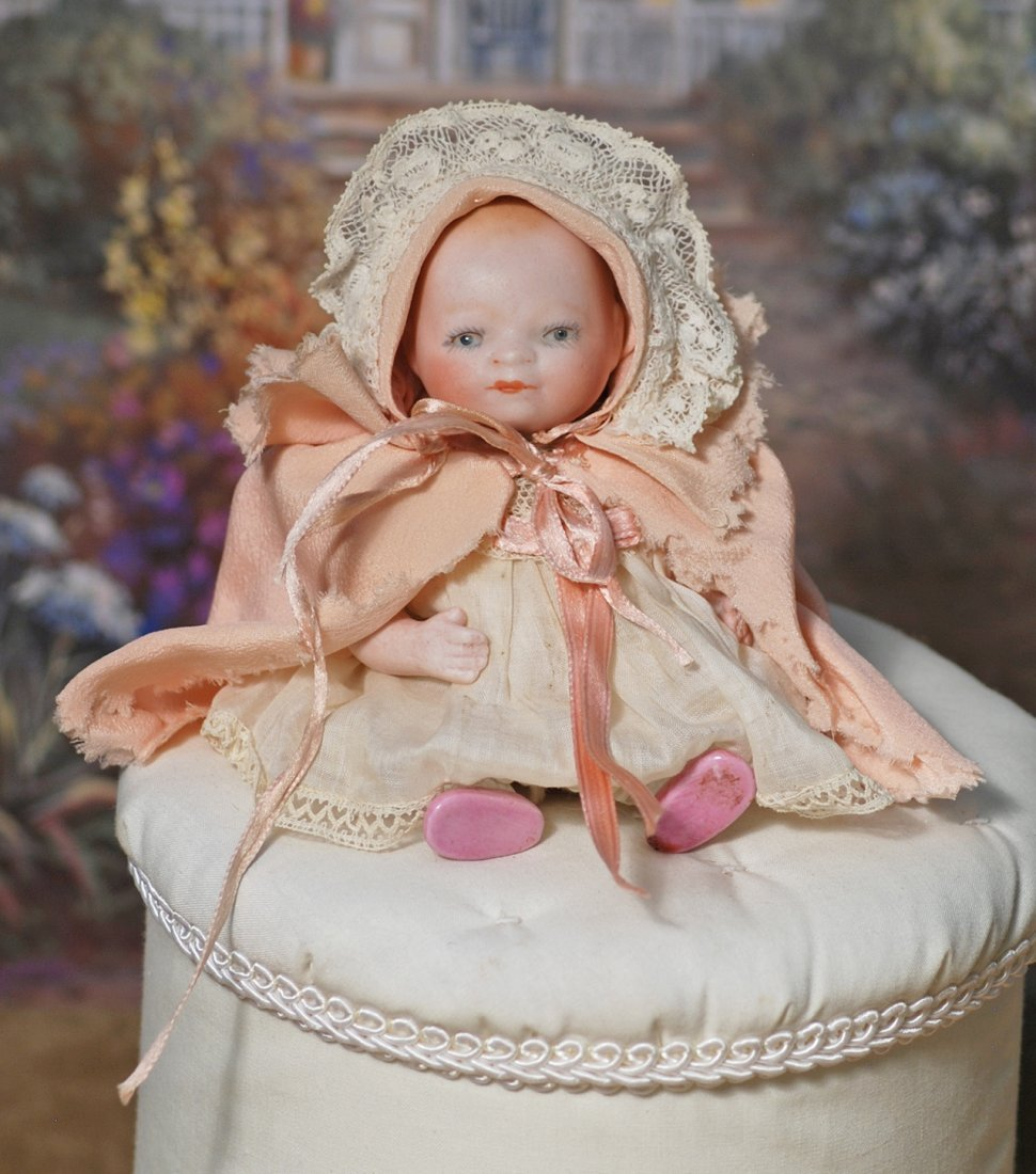 GERMAN BISQUE BYE-LO BABY WITH GLASS EYES AND SWIVEL