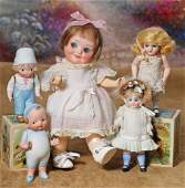 TWO GERMAN ALL-BISQUE CHARACTER DOLLS. Each is