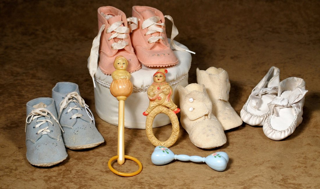 GROUP OF BABY SHOES AND RATTLES.Includes three pair of