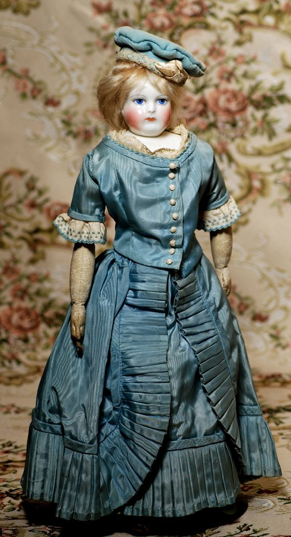 FRENCH PORCELAIN DOLL WITH RARE SWIVEL NECK BY LEONTINE