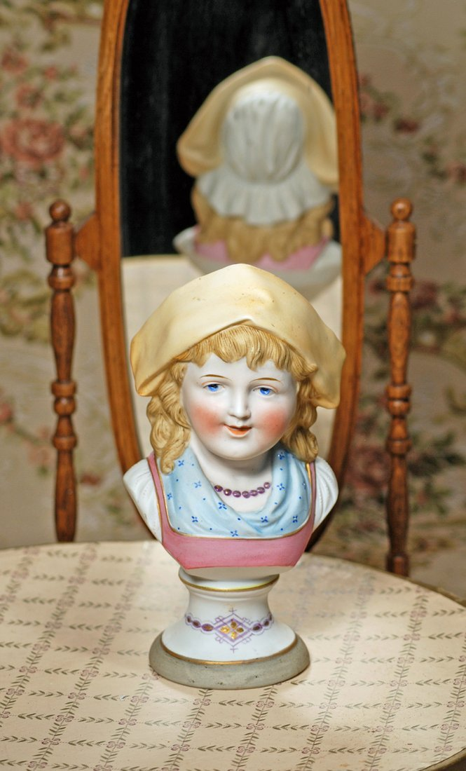 GERMAN BISQUE BUST OF YOUNG GIRL WITH CHARACTER FACE