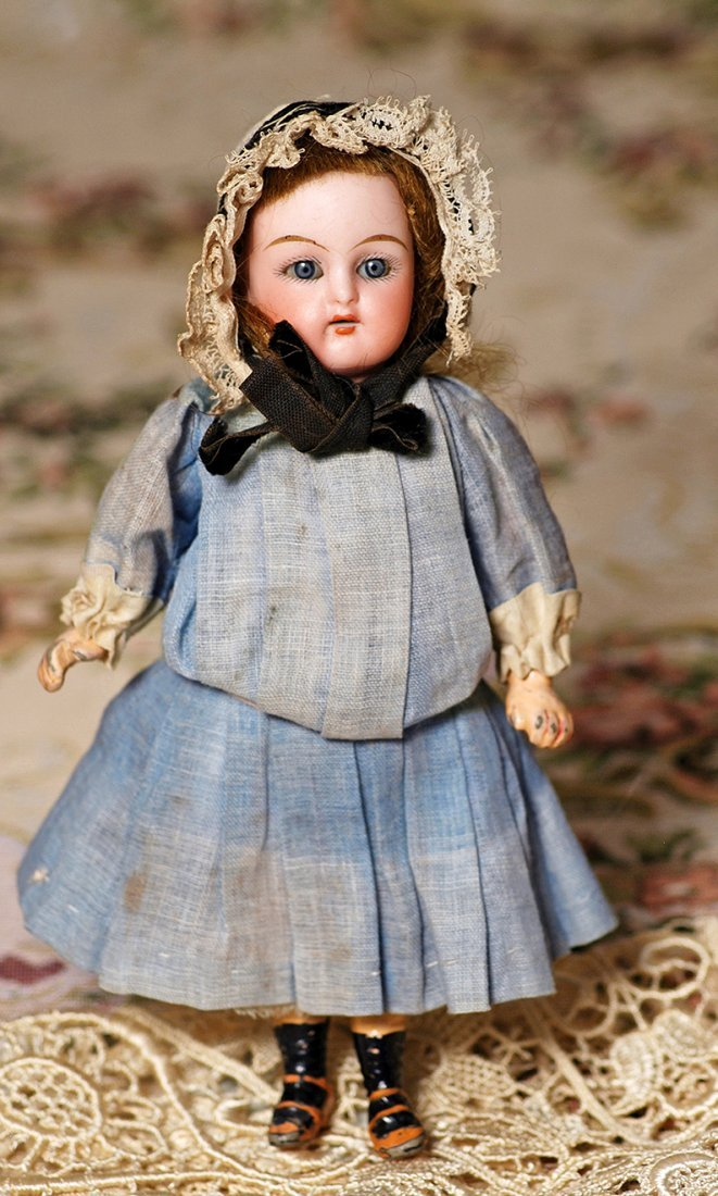 TINY GERMAN BISQUE DOLL  WITH WALKER BODY BY KAMMER &