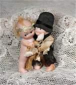 PAIR OF GERMAN BISQUE KEWPIE HUGGERS AS BRIDE AND GROOM