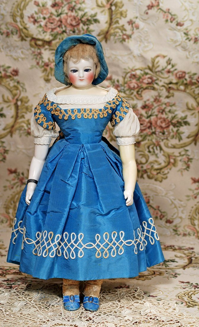FRENCH PORCELAIN POUPEE WITH BLUE GLASS EYES ATTRIBUTED