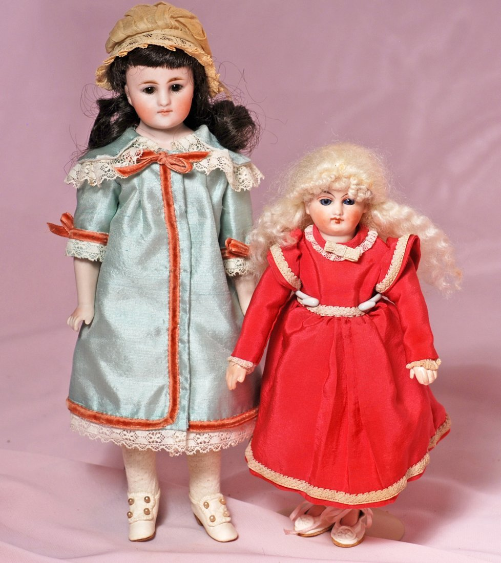 TWO GERMAN CLOSED-MOUTH SMALL DOLLS