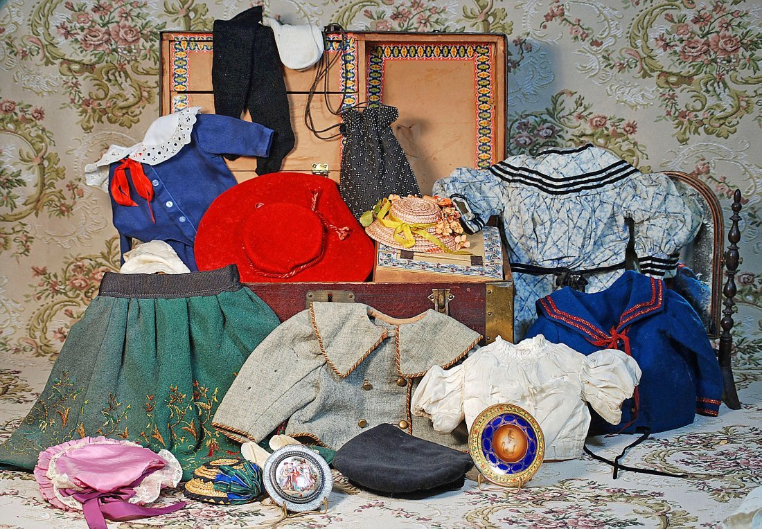 ANTIQUE TRUNK WITH ASSORTED CLOTHING AND ACCESSORIES.