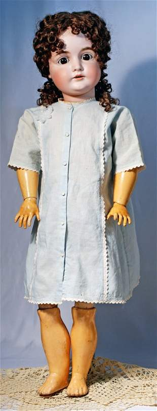 LARGE KESTNER BISQUE DOLL WITH PRETTY FACE.