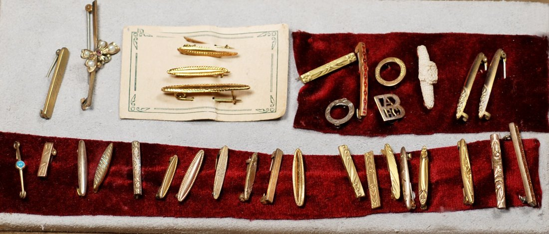 COLLECTION OF THIRTY-TWO ANTIQUE BEBE PINS.