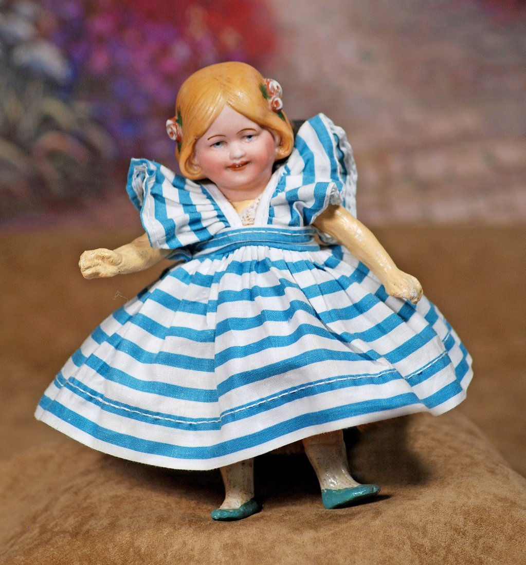 TINY GERMAN BISQUE CHARACTER DOLL BY GOEBEL.