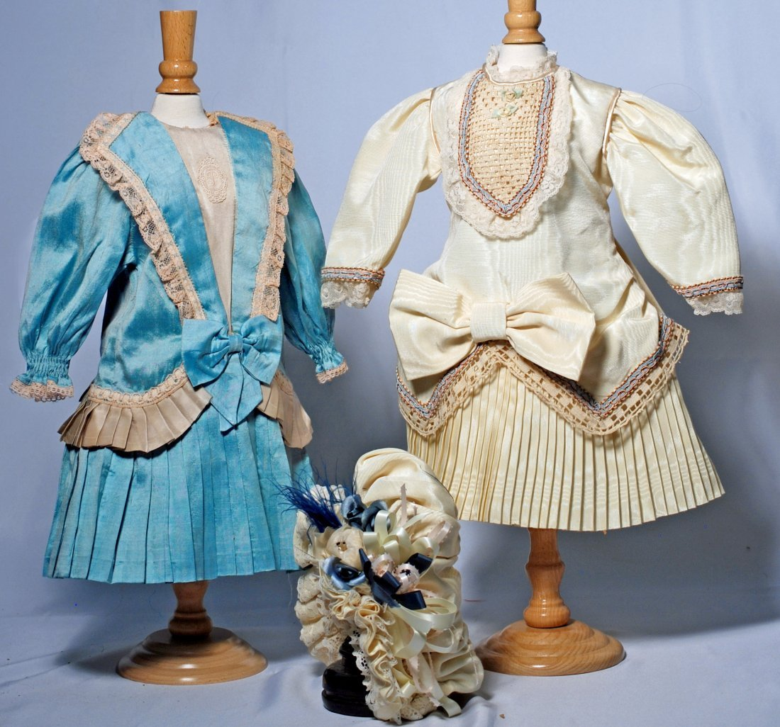 TWO FRENCH-STYLE DOLL DRESSES.