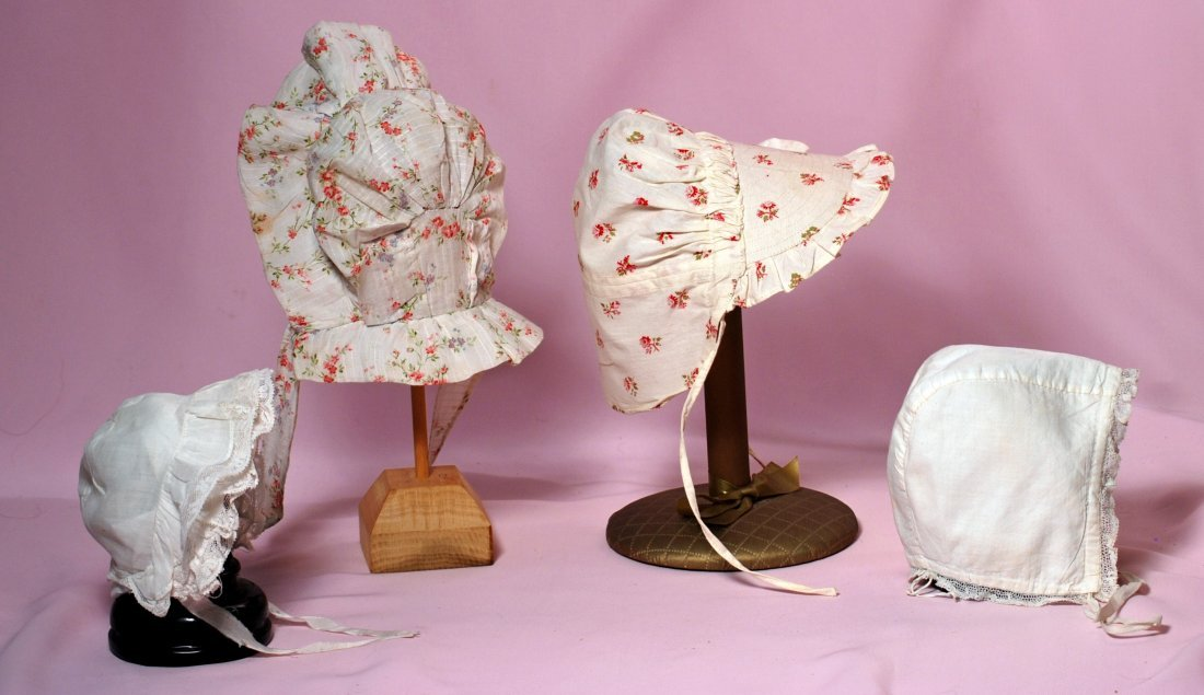 FOUR ANTIQUE DOLL BONNETS.
