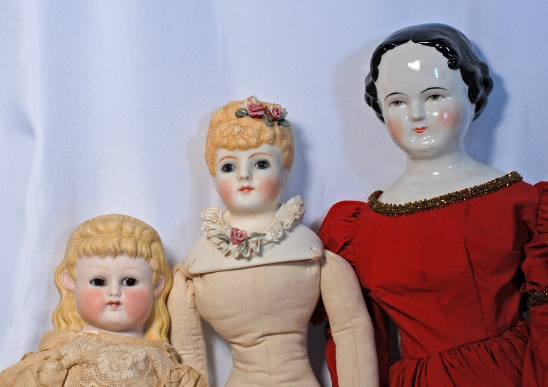 FOUR BISQUE AND CHINA REPRODUCTION DOLLS. - 2