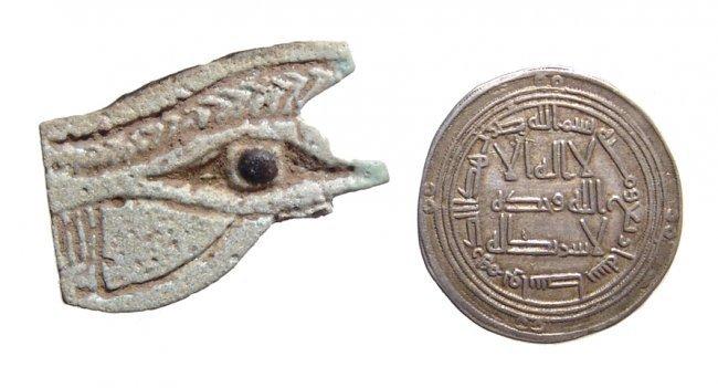 Egyptian faience Eye of Horus amulet and Islamic Dirhem