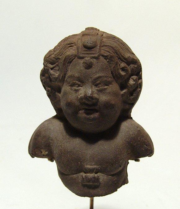 An Egyptian terracotta bust of an Erote, Roman