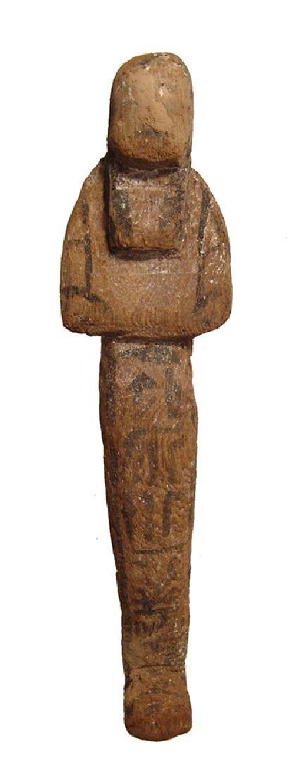 An Egyptian wood ushabti, Late New Kingdom