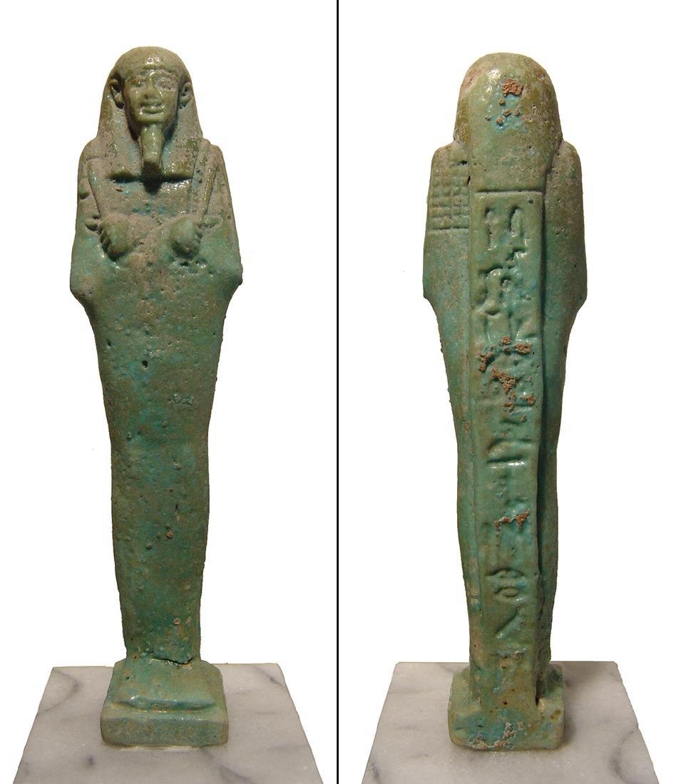 A beautiful Egyptian pale blue-green faience ushabti