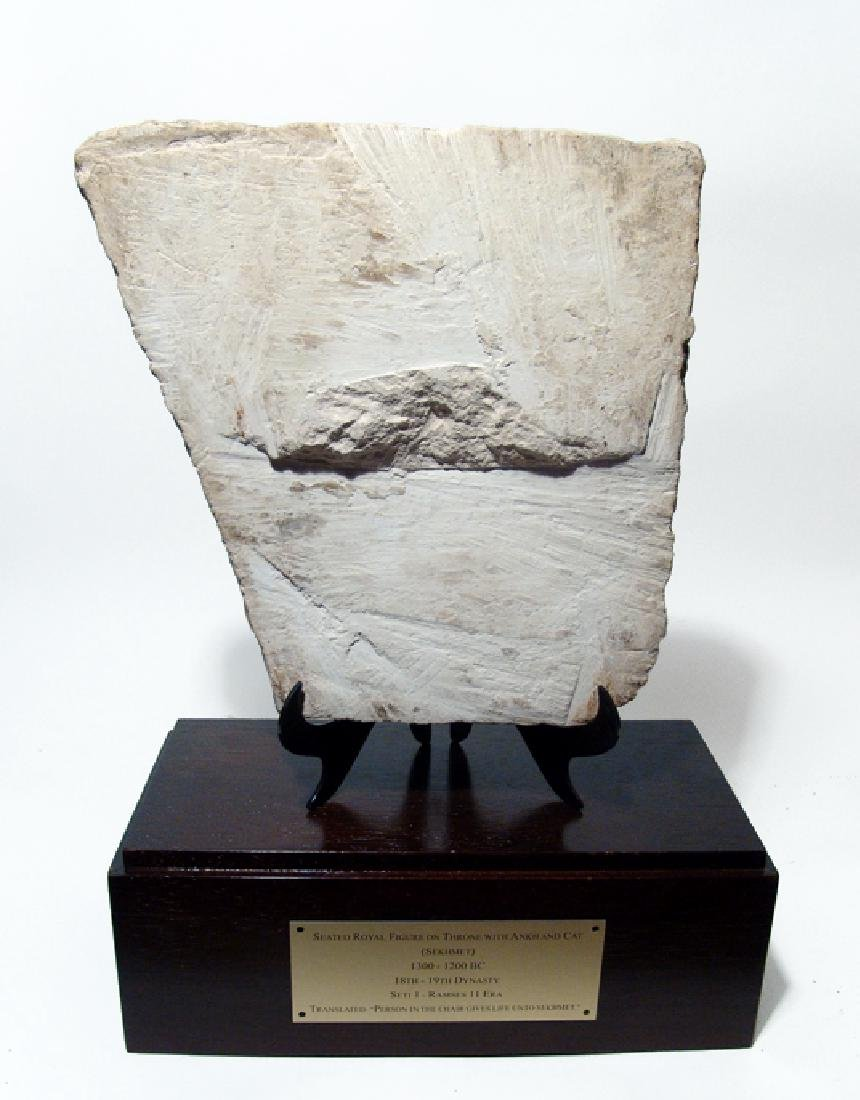 Egyptian limestone relief depicting seated royal figure - 4