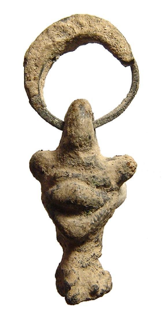 A Mesopotamian bronze amulet of Pazuzu