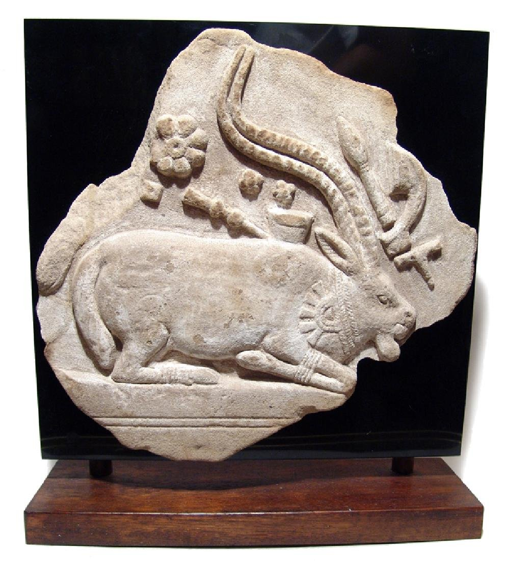 A choice Indus Valley sandstone relief of kneeling ibex
