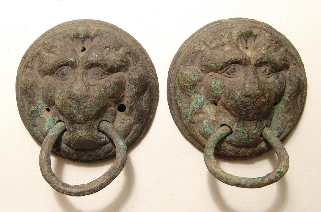 A pair of heavy Roman bronze lion-faced finials