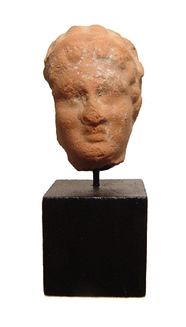 A Greek terracotta female head