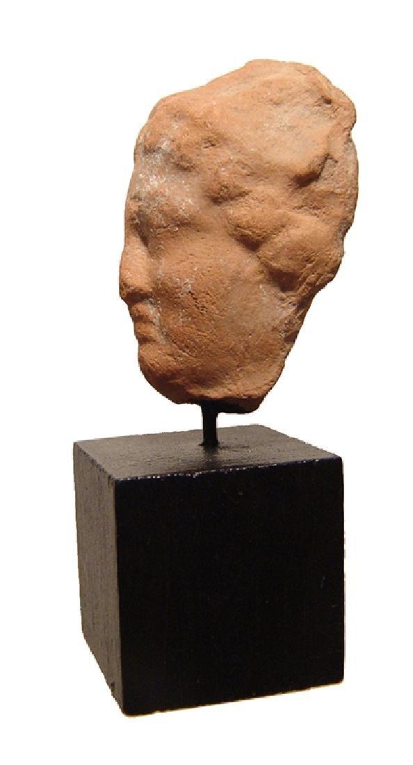 A Greek terracotta female head - 2