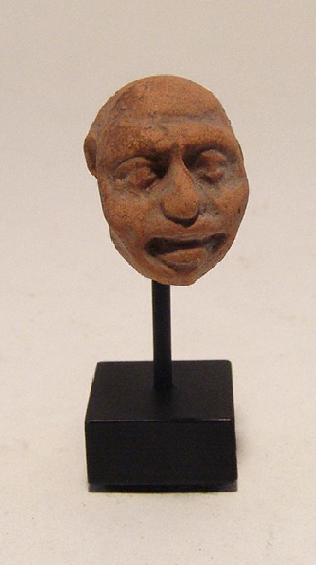 A Greek terracotta head of a grotesque - 2