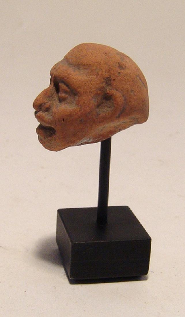 A Greek terracotta head of a grotesque - 3