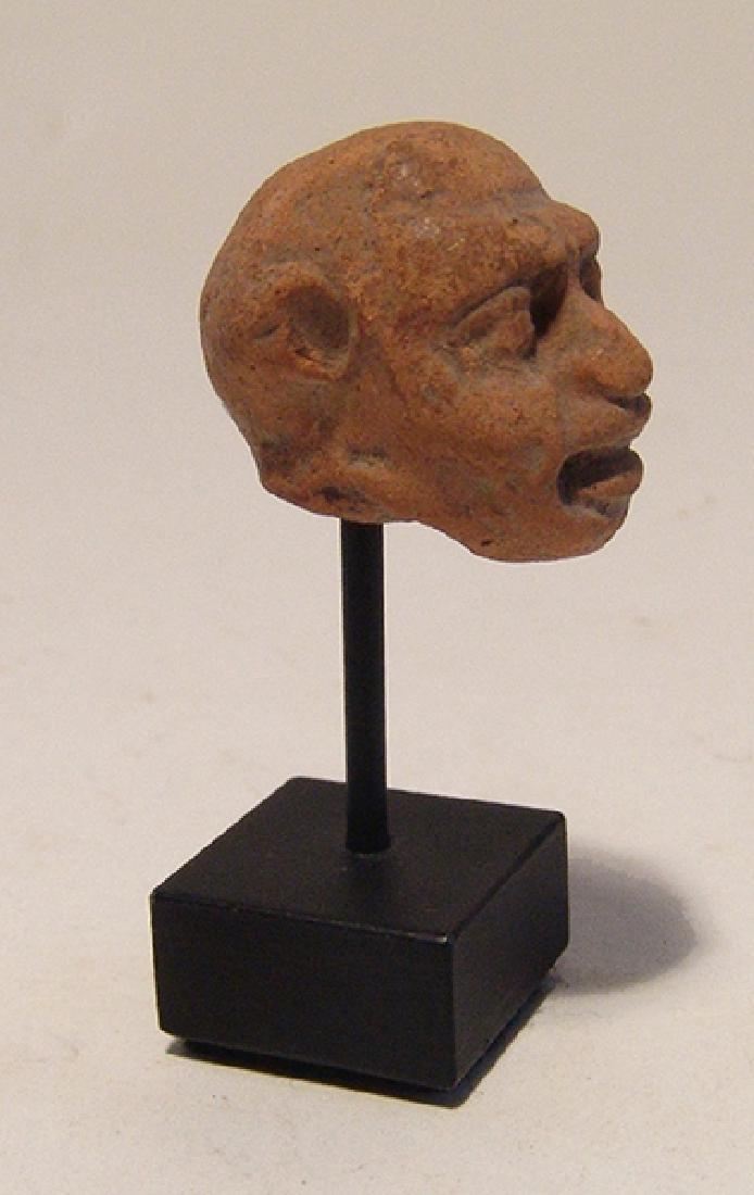 A Greek terracotta head of a grotesque - 4