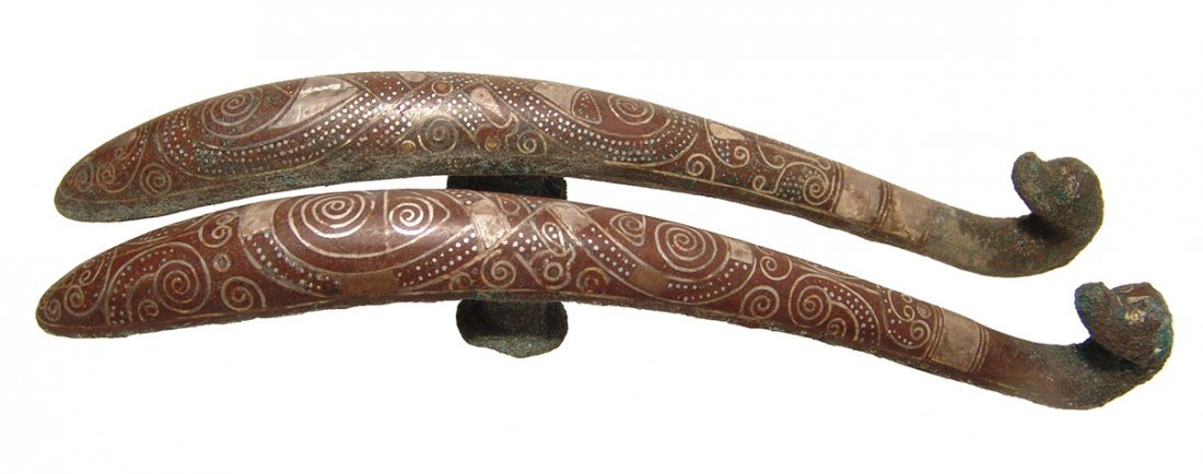 A pair of beautifully silver inlaid bronze belt hooks